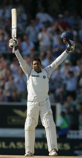 India's Anil Kumble celebrates his maiden test century against England the second days play of the third cricket test at the Oval cricket ground in London on Friday.
