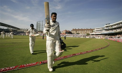 India's Anil Kumble walks off the pitch at the end of the Indian first inning after scoring his maiden test century and top scored with an undefeated 110 runs against England the second days play of the third cricket test at the Oval cricket ground in London on Friday.