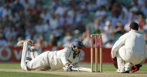 India's Anil Kumble falls in making the runs that take him to his maiden test century against England the second days play of the third cricket test at the Oval cricket ground in London on Friday.