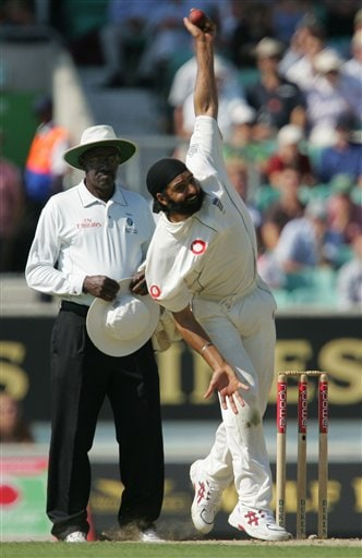 England's Monty Panesar bowls as umpire Steve Bucknor looks on the second day of the third cricket test at the Oval cricket ground in London on Friday.