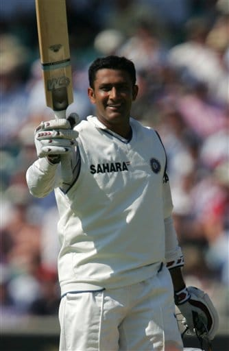 India's Anil Kumble celebrates getting 50 runs against England on the second day of the third cricket test at the Oval cricket ground in London on Friday.