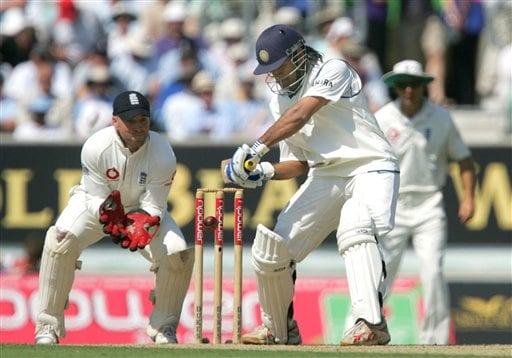 India's Mahendra Singh Dhoni prepares to play a shot off England's Monty Pansear on the second day of the third cricket test at the Oval cricket ground in London on Friday.