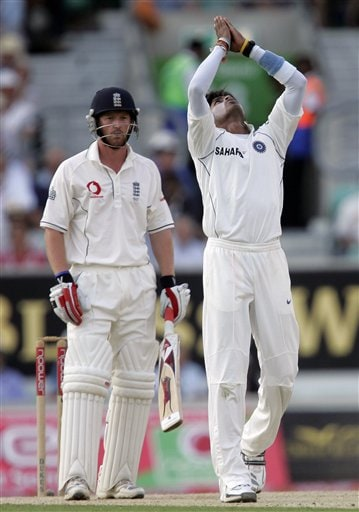 India' S Sreesanth, right, appeals successfully for the wicket of England' Paul Collingwood, left, during the third days play of the third cricket test at the Oval cricket ground in London on Saturday.