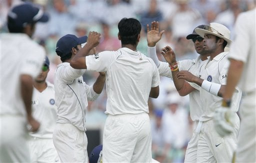 India's RP Singh, center back turned, celebrates taking the wicket of England's James Anderson on the third days play of the third cricket test at the Oval cricket ground in London on Saturday.