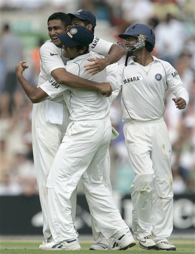 Anil Kumble, at left celebrates with team mate RP Singh after taking the wicket of England's captain Michael Vaughn, caught and bowled on the third days play of the third cricket test at the Oval cricket ground in London on Saturday.