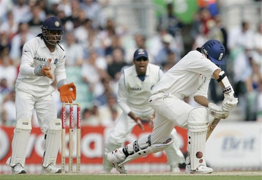 Engalnd's Monty Panesar right, is hit on the pads as the Indian keeper Mahendra Dhoni, left, and teammates appeal for lbw off the bowling of Anil Kumble on the fourth days play of the third cricket test at the Oval cricket ground in London on Sunday.