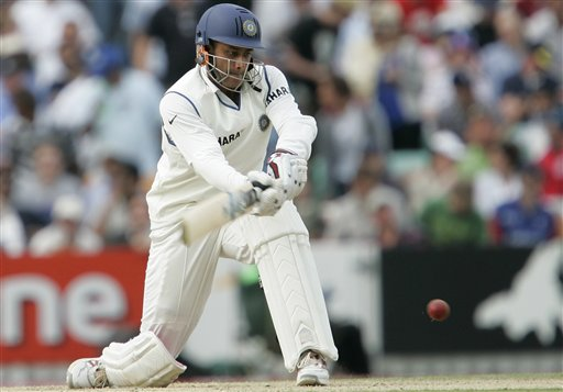 India's VVS Laxman sweeps England's Monty Panesar on the fourth days play of the third cricket test at the Oval cricket ground in London on Sunday.