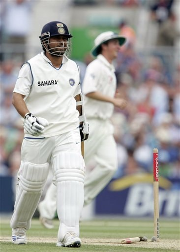 India's Sachin Tendulkar walks from the pitch after being bowled by England's James Anderson, unseen, on the fourth days play of the third cricket test at the Oval in London on Sunday.