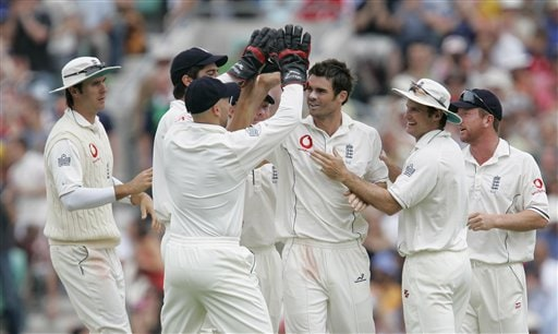 England's James Anderson ,centre is congratulated by teammates after bowling out India's Sachin Tendulkar on the fourth days play of the third cricket test at the Oval in London on Sunday.