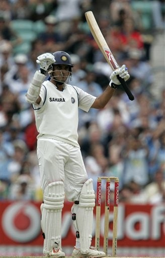 India's Sourav Ganguly celebrates getting his 50 runs against England in his second innings on the fourth days play of the third cricket test at the Oval cricket ground in London on Sunday.
