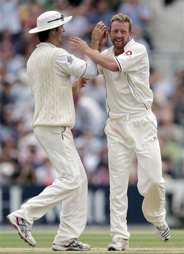 England's Paul Collingwood, right, celebrates taking the wicket of India's Sourav Ganguly, with captain Michael Vaughan on the fourth days play of the third cricket test at the Oval cricket ground in London on Sunday.