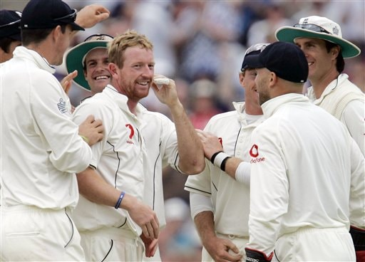England's Paul Collingwood ,centre left, celebrates with teammates taking the wicket of India's Rahul Dravid on the fourth day's play of the third cricket test at the Oval in London on Sunday.