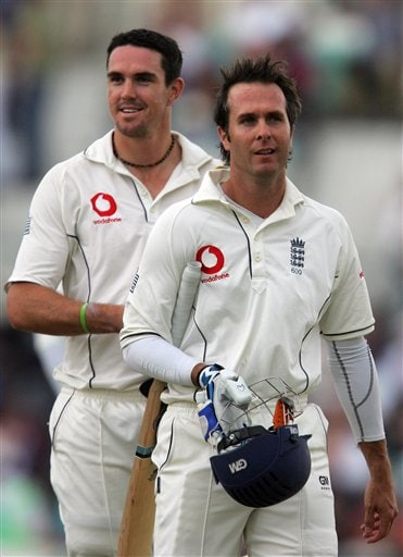 England's captain Michael Vaughn and Kevin Piertsen walk off the pitch as they take advantage off bad light offered to them by the umpires on the fifth days play of the third cricket test against India at the Oval cricket ground in London, Monday, Aug. 13, 2007.