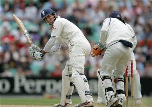 England's Michael Vaughn looks back as the ball slips between the legs of India's keeper Dhoni on the fifth days play of the third cricket test at the Oval cricket ground in London, Monday, Aug. 13, 2007.