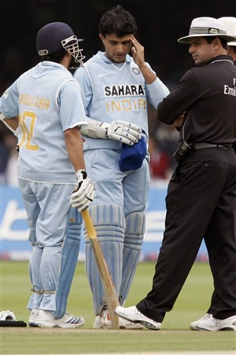 India's Sourav Ganguly, centre, rubs his head after being hit by a ball from England's James Anderson during the final one day international cricket match at Lords, London on Saturday.
