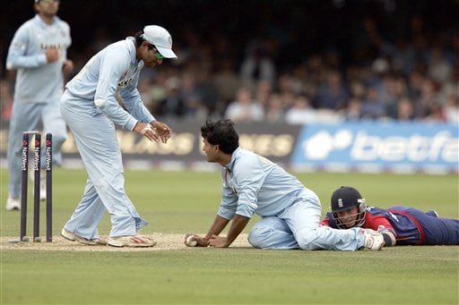 India's Robin Uthappa, left, congratulates Sourav Ganguly, centre, after he runs out England's Ian Bell left, during the final one day international cricket match at Lords, London on Saturday.