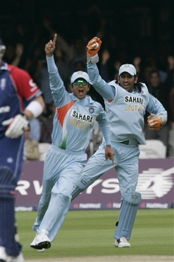 India's Mahendra Dhoni, right, and Rahul Dravid, left, celebrate after the wicket of England's Matt Prior falls during the final one day international cricket match at Lords, London on Saturday.