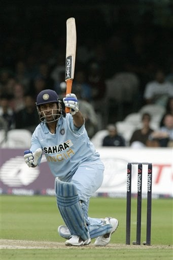 India's Mahendra Dhoni hits a ball from England's Stuart Broad during the final one day international cricket match at Lords, London on Saturday.