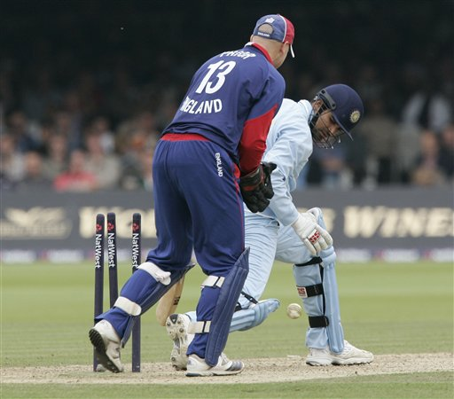 India's Zaheer Khan, right,looks behind to see his wicket broken by a ball from England's Monty Panesar during the final one day international cricket match at Lords, London on Saturday.