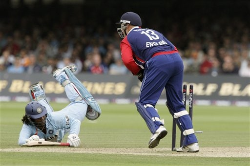 England's Matt Prior, right, breaks the wicket and India's Ramesh Powar, left, is run out during the final one day international cricket match at Lords, London on Saturday.