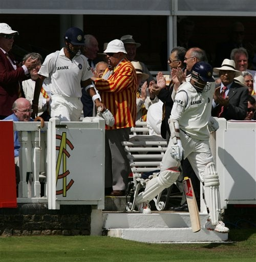 India's Sourav Ganguly, right, and RP Singh take to the field at the start of the third day of the first Test against England at Lord's cricket ground, London on Saturday.