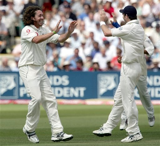 England's James Anderson, right, congratulates Ryan Sidebottom after he claims the wicket of India's VVS Laxman during the third day of the first Test at Lord's cricket ground, London on Saturday.