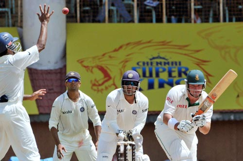 VVS Laxman, left, tries to catch the ball shot by South Africa's captain Graeme Smith, right, as wicketkeeper Mahendra Singh Dhoni and Rahul Dravid react during the first Test of the Future Cup cricket series in Chennai on Wednesday, March 26, 2008.