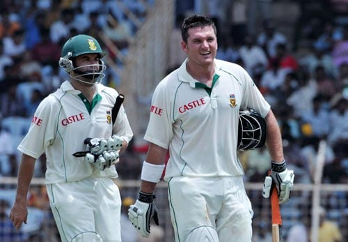 Graeme Smith, right, and Niel McKenzie walk during a lunch break during the first Test of the Future Cup series in Chennai on Wednesday, March 26, 2008. Smith and McKenzie scored 53 and 54 runs against India.