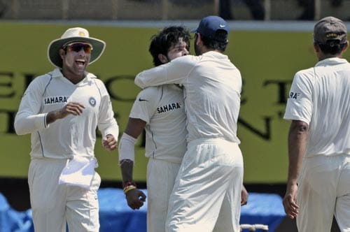 Yuvraj Singh, second from right, hugs bowler S. Sreesanth for the dismissal of South Africa's A.B. de Villiers, as captain Anil Kumble, right, and VVS Laxman, left, join the celebration during the second day of the first Test match of the Future Cup series in Chennai on Thursday, March 27, 2008.