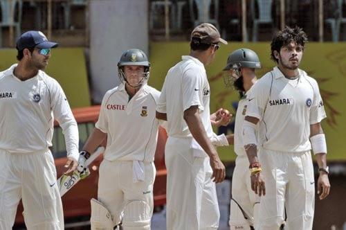 Anil Kumble, centre front, talks with South Africa's A.B. de Villiers, second left, after a altercation with bowler S. Sreesanth, right, as Yuvraj Singh, left and Hashim Amla, second right, look on during second day of the first Test match of the Future Cup series in Chennai on Thursday, March 27, 2008.