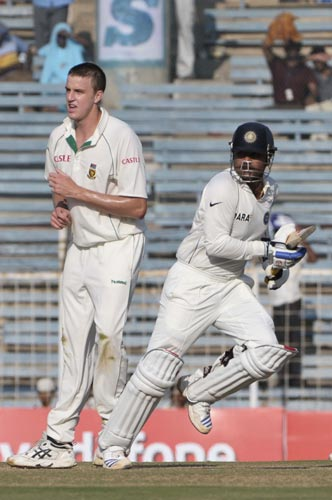 Virender Sehwag, right, scores a run as South Africa's bowler Morne Morkel gestures during the second day of first Test of Future Cup series in Chennai on Thursday, March 27, 2008. South Africa scored 540 in the first innings against India.