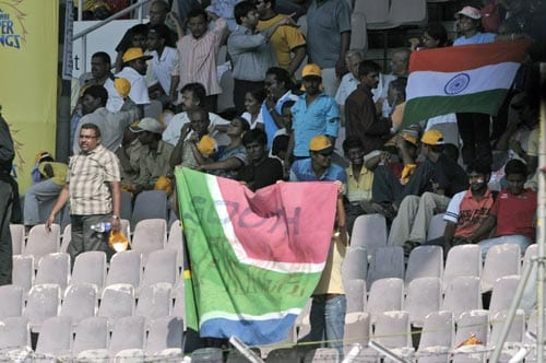 Indian cricket enthusiasts flash Indian and South African national flags during the second day of the first Test match of the Future Cup series in Chennai on Thursday, March 27, 2008.