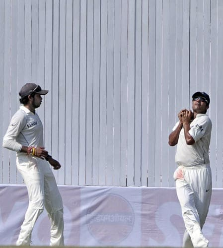 Sourav Ganguly, right, takes a catch to dismiss Morne Morkel to end South Africa's first innings, as S Sreesanth, left, watches during second day of the first Test match of the Future Cup series in Chennai on Thursday, March 27, 2008.