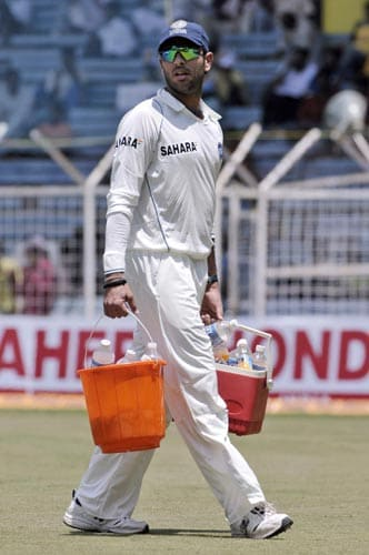 India's 12th man Yuvraj Singh walks with drinks during second day of the first Test match of the Future Cup series in Chennai on Thursday, March 27, 2008.