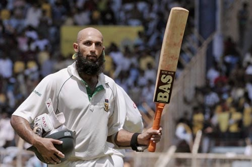 Hashim Amla acknowledges the crowd as he walks away after his dismissal during the second day of the first Test match of the Future Cup series in Chennai on Thursday, March 27, 2008. Amla scored 159 runs against India.