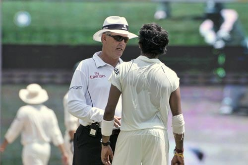 Umpire Tony Hill, left, talks with S. Sreesanth after the latter got involved in an altercation with South Africa's A.B. de Villiers during the second day of the first Test match of the Future Cup series in Chennai on Thursday, March 27, 2008.