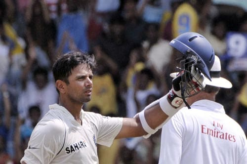 Rahul Dravid, left, acknowledges the crowd after setting a milestone of 10,000 runs in a Test cricket, during the fourth day of the first Test match of the Future Cup series against South Africa in Chennai on Saturday, March 29, 2008.