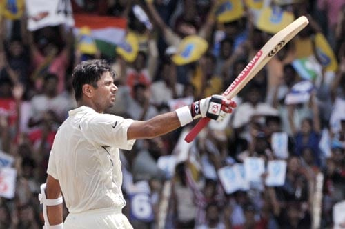 Rahul Dravid acknowledges the crowd after setting a milestone of 10,000 runs in Test cricket, during fourth day of the first Test match of the Future Cup series in Chennai on March 29, 2008.
