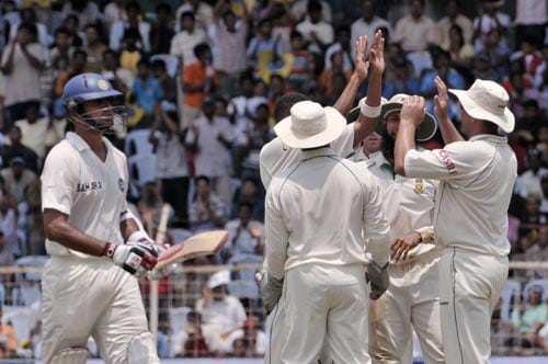 South Africa's cricketers celebrate the dismissal of Rahul Dravid, left, during fourth day of the first Test match of the Future Cup series in Chennai, India, Saturday, March 29, 2008.