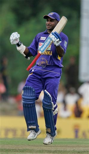 Sanath Jayasuriya celebrates as he completes a century during the first one-day cricket international of the five match series between India and Sri Lanka in Dambulla on Wednesday January 28, 2009. (AP Photo)