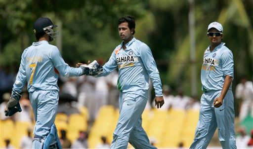 Pragyan Ojha, centre, celebrates the wicket of Kumar Sangakkara, unseen, with Mahendra Singh Dhoni, left, as Suresh Raina looks on during the first one-day cricket international of the five match series between India and Sri Lanka in Dambulla on Wednesday, January 28, 2009. (AP Photo)