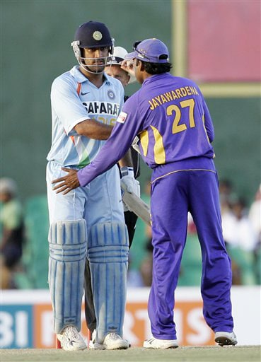 Mahendra Singh Dhoni shakes hands with Mahela Jayawardene after the end of the first ODI match between the two teams in Dambulla on Wednesday. (AP Photo)