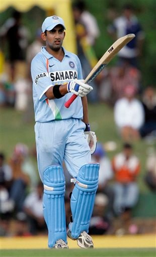 Gautam Gambhir acknowledges the crowd as he completes his half-century during the first One-Day International match between India and Sri Lanka in Dambulla on Wednesday, January 28, 2009. (AP Photo)