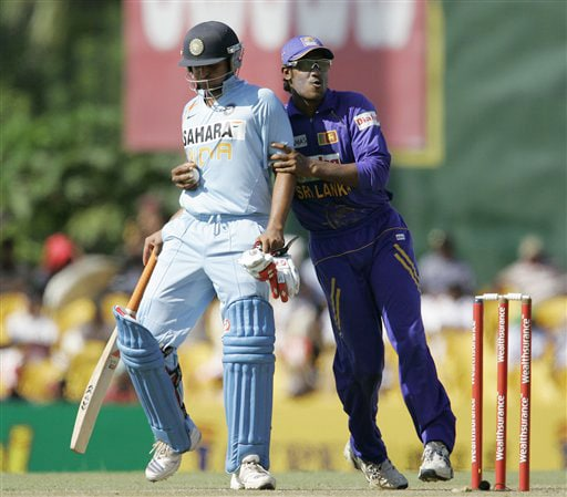 Chamara Kapugedera playfully holds Suresh Raina during the first ODI of the five match series between India and Sri Lanka in Dambulla on Wednesday. (AP Photo)