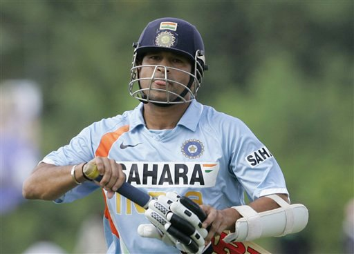 Sachin Tendulkar reacts as he leaves the field after being out during the first ODI of the five match series between India and Sri Lanka in Dambulla on Wednesday. (AP Photo)