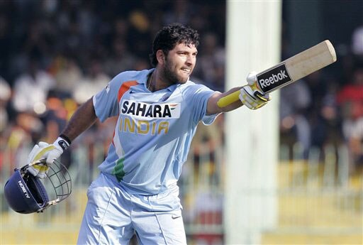 Yuvraj Singh reacts after completing a century during the third ODI of the five-match series between India and Sri Lanka in Colombo. (AP Photo)