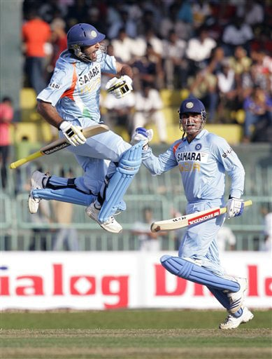 Yuvraj Singh jumps in the air after completing a century as his teammate Virender Sehwag looks on during the third ODI of the five-match series between India and Sri Lanka in Colombo. (AP Photo)