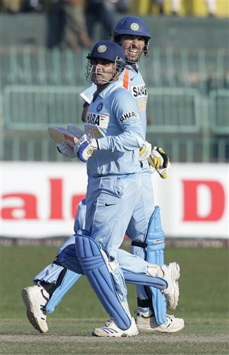 Virender Sehwag and Yuvraj Singh run between the wickets during their third ODI of the five-match series against Sri Lanka, in Colombo. (AP Photo)