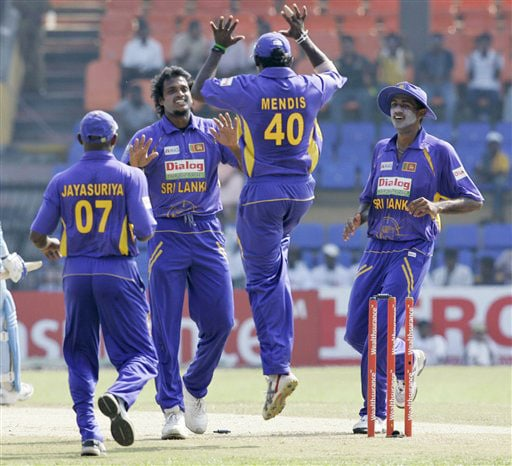Sri Lankan bowler Dilhara Fernando celebrates the dismissal of Gautam Gambhir with his teammates during their third ODI match of the five-match series in Colombo. (AP Photo)