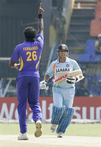 Sachin Tendulkar looks on after being dismissed as Dilhara Fernando celebrates during the third ODI of the five-match series between India and Sri Lanka in Colombo. (AP Photo)